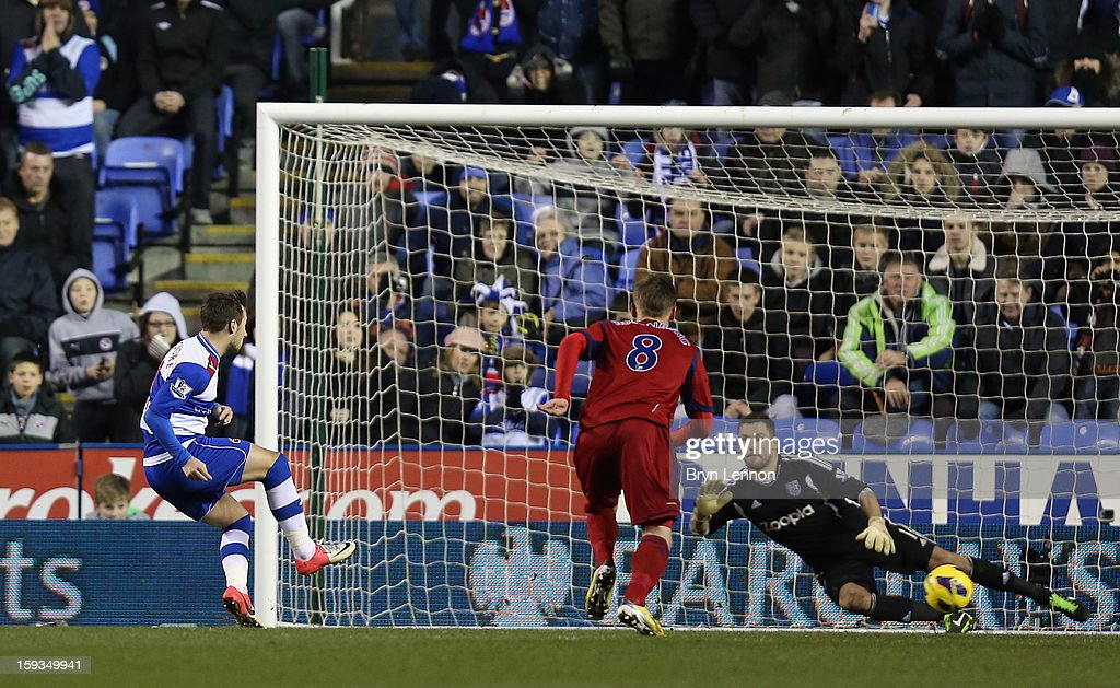 Adam Le Fondre of Reading scores from a penalty during the Barclays Premier League match between Reading and West Bromwich Albion at the Madejski Stadium on January 12, 2013 in Reading, England.