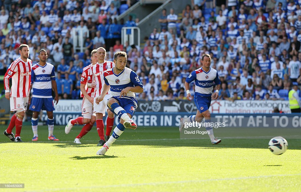 Adam Le Fondre of Reading scores from the penalty spot during the Barclays Premier League match between Reading and Stoke City at Madejski Stadium on August 18, 2012 in Reading, England.