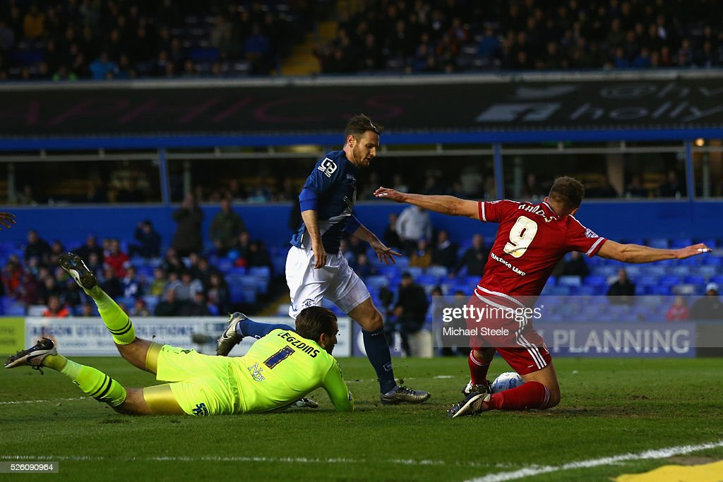 Adam Legzdins of Birmingham City fails to prevent <a gi-track='captionPersonalityLinkClicked' href=/galleries/search?phrase=Jordan+Rhodes+-+Soccer+Player&family=editorial&specificpeople=12860183 ng-click='$event.stopPropagation()'>Jordan Rhodes</a> of Middlesbrough scoring the equalising goal during the Sky Bet Championship match between Birmingham City and Middlesbrough at St Andrews on April 29, 2016 in Birmingham, United Kingdom.