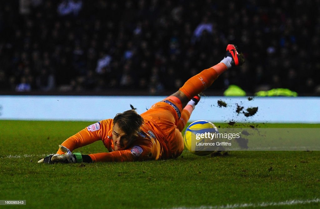 Adam Legzdins of Derby County dives to make a save during the FA Cup with Budweiser Fourth Round match between Derby County and Blackburn Rovers at Pride Park Stadium on January 26, 2013 in Derby, England.