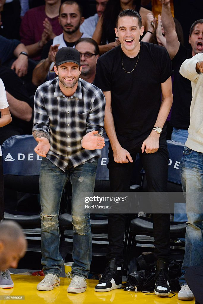 Adam Levine and GEazy attend a basketball game between the Toronto Raptors and the Los Angeles Lakers at Staples Center on November 30 2014 in Los...