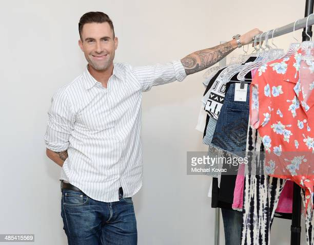 Adam Levine celebrates the launch of his new women's collection for Kmart and Shop Your Way at Ace Gallery on April 17 2014 in Los Angeles California