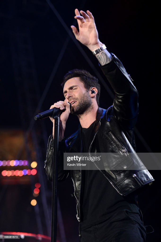<a gi-track='captionPersonalityLinkClicked' href=/galleries/search?phrase=Adam+Levine+-+S%C3%A4nger&family=editorial&specificpeople=202962 ng-click='$event.stopPropagation()'>Adam Levine</a> of Maroon 5 performs at 102.7 KIIS FM's Wango Tango 2013 held at The Home Depot Center on May 11, 2013 in Carson, California.