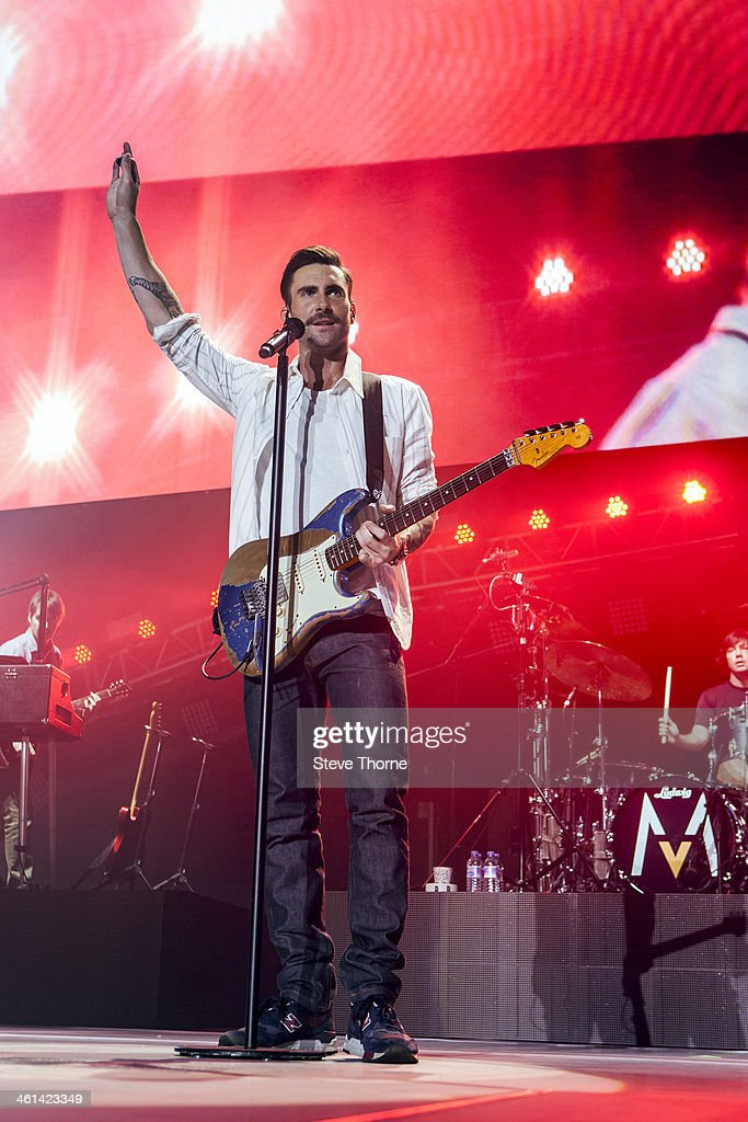 Adam Levine of Maroon 5 performs on stage at LG Arena on January 8, 2014 in Birmingham, United Kingdom.