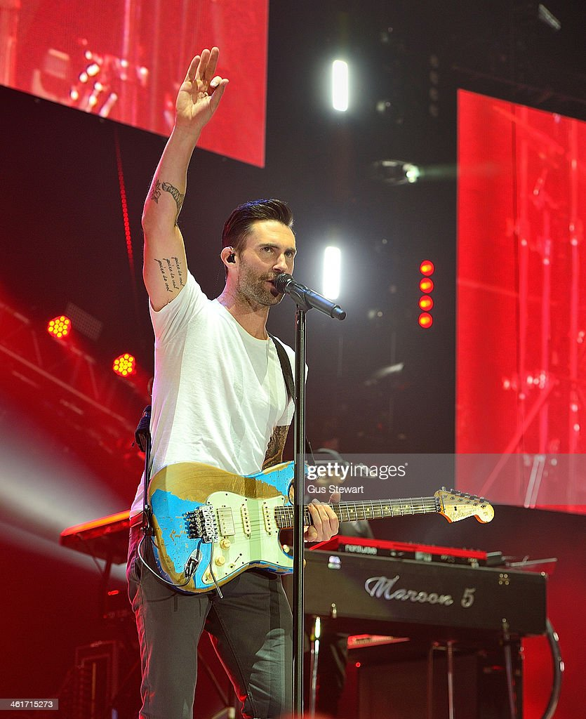 <a gi-track='captionPersonalityLinkClicked' href=/galleries/search?phrase=Adam+Levine+-+Singer&family=editorial&specificpeople=202962 ng-click='$event.stopPropagation()'>Adam Levine</a> of Maroon 5 performs on stage at O2 Arena on January 10, 2014 in London, United Kingdom.