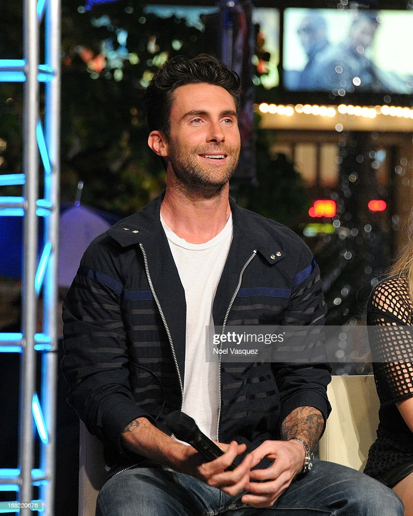 <a gi-track='captionPersonalityLinkClicked' href=/galleries/search?phrase=Adam+Levine+-+Singer&family=editorial&specificpeople=202962 ng-click='$event.stopPropagation()'>Adam Levine</a> visits 'Extra' at The Grove on May 6, 2013 in Los Angeles, California.