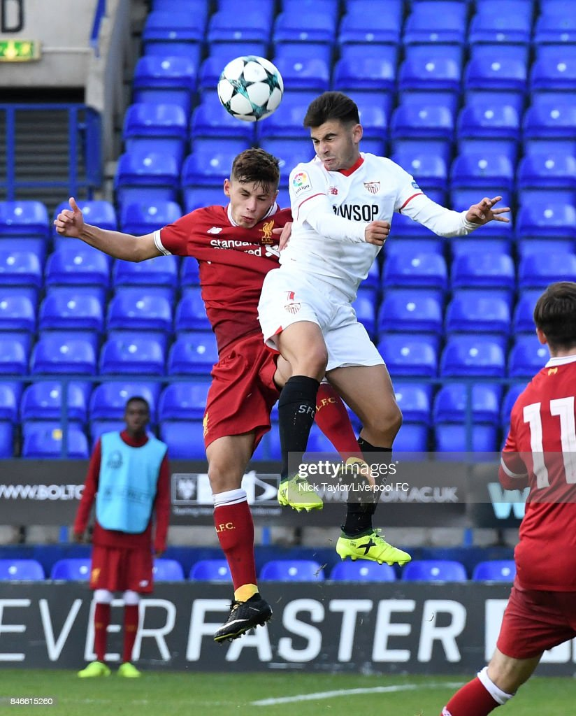 Adam Lewis of Liverpool and Jose Alonso Lara of Sevilla in action during the UEFA Champions League group E match between Liverpool FC and Sevilla FC at Prenton Park on September 13, 2017 in Birkenhead, United Kingdom.