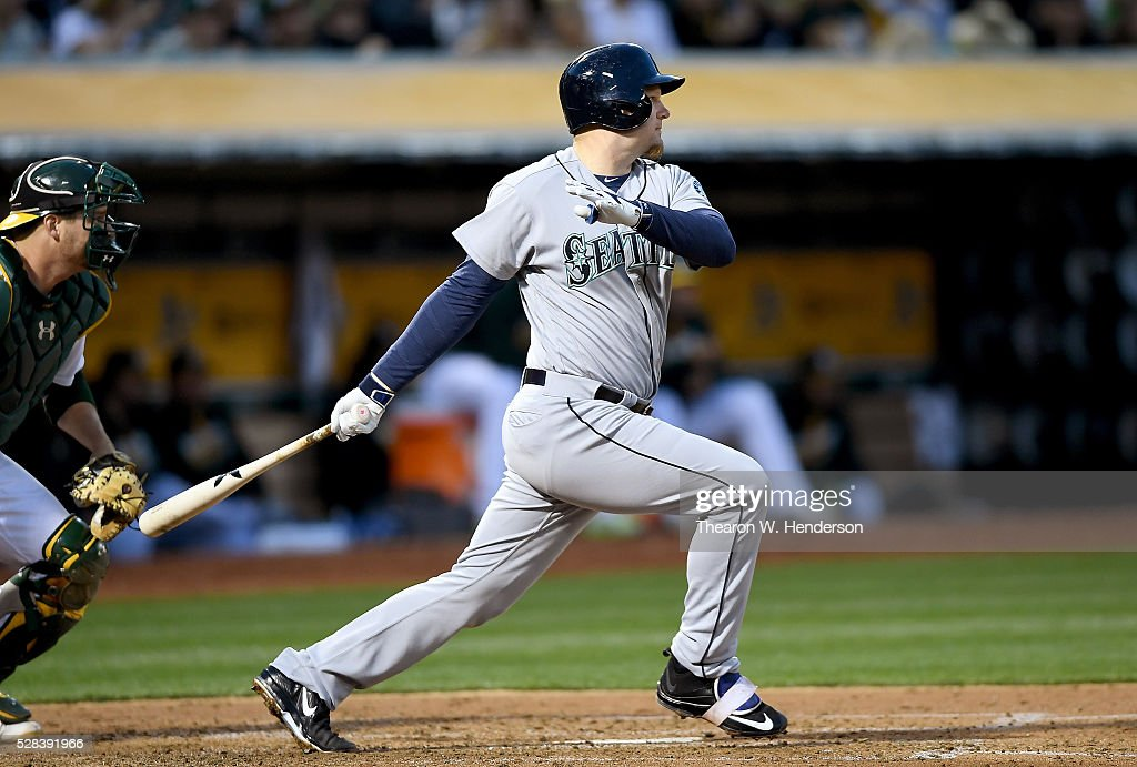 <a gi-track='captionPersonalityLinkClicked' href=/galleries/search?phrase=Adam+Lind&family=editorial&specificpeople=3911783 ng-click='$event.stopPropagation()'>Adam Lind</a> #26 of the Seattle Mariners hits an rbi single scoring Robinson Cano #22 against the Oakland Athletics in the top of the fourth inning at O.co Coliseum on May 2, 2016 in Oakland, California.