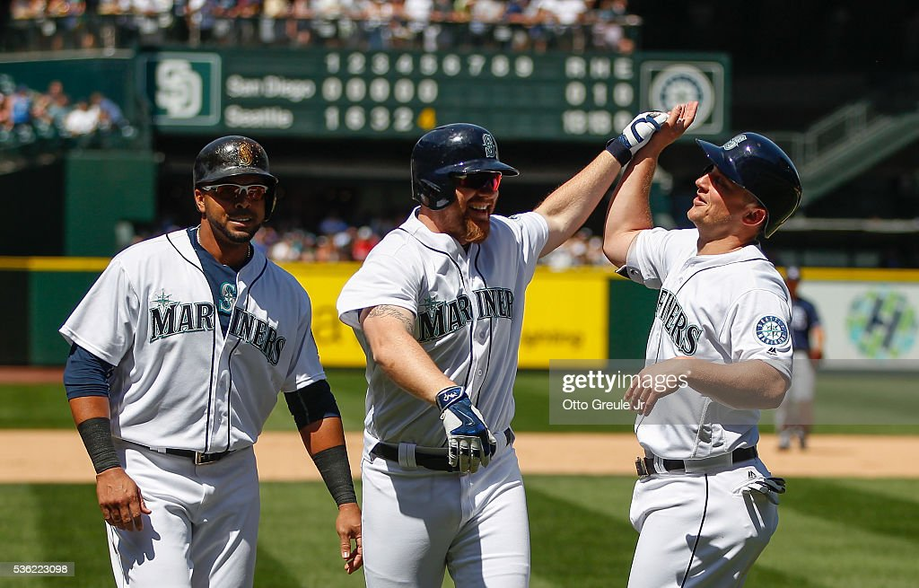 <a gi-track='captionPersonalityLinkClicked' href=/galleries/search?phrase=Adam+Lind&family=editorial&specificpeople=3911783 ng-click='$event.stopPropagation()'>Adam Lind</a> #26 of the Seattle Mariners is congratulated by <a gi-track='captionPersonalityLinkClicked' href=/galleries/search?phrase=Nelson+Cruz&family=editorial&specificpeople=235459 ng-click='$event.stopPropagation()'>Nelson Cruz</a> #23 (L) and Kyle Seager #15 after hitting a three-run homer against the San Diego Padres in the fifth inning at Safeco Field on May 31, 2016 in Seattle, Washington.