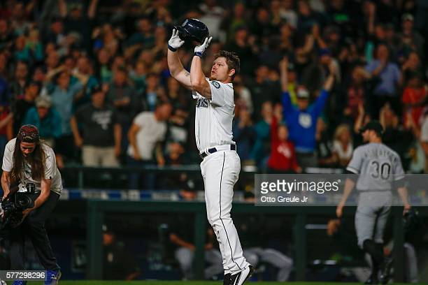 Adam Lind of the Seattle Mariners 'jump shoots' his helmet as he crosses home plate following a 3run walk off home run to beat the Chicago White Sox...
