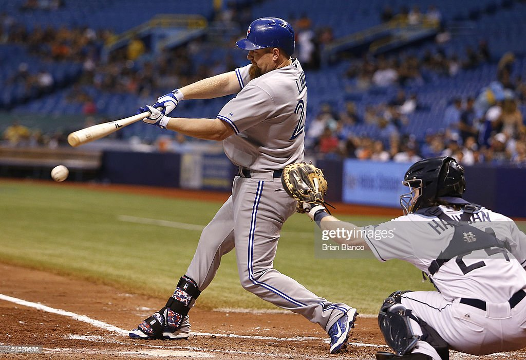 <a gi-track='captionPersonalityLinkClicked' href=/galleries/search?phrase=Adam+Lind&family=editorial&specificpeople=3911783 ng-click='$event.stopPropagation()'>Adam Lind</a> #26 of the Toronto Blue Jays grounds into a double play in front of catcher <a gi-track='captionPersonalityLinkClicked' href=/galleries/search?phrase=Ryan+Hanigan&family=editorial&specificpeople=833982 ng-click='$event.stopPropagation()'>Ryan Hanigan</a> #24 of the Tampa Bay Rays during the third inning of a game on September 2, 2014 at Tropicana Field in St. Petersburg, Florida.
