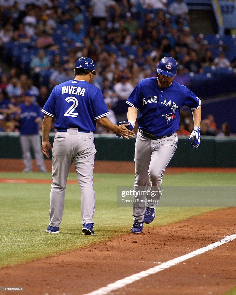 <a gi-track='captionPersonalityLinkClicked' href=/galleries/search?phrase=Adam+Lind&family=editorial&specificpeople=3911783 ng-click='$event.stopPropagation()'>Adam Lind</a> #26 of the Toronto Blue Jays hits a solo homerun and is congratulated by Luis Rivera #2 in the sixth inning against the Tampa Bay Rays during the game on August 17, 2013 at Tropicana Field in St. Petersburg, Florida.
