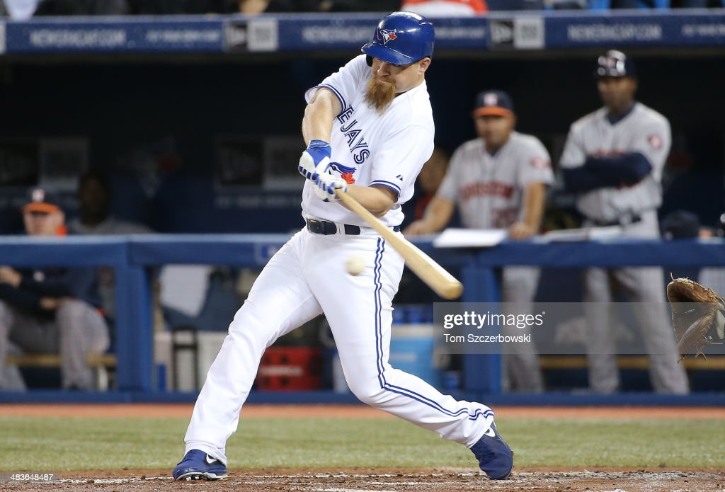 Adam Lind #26 of the Toronto Blue Jays hits an RBI single in the first inning during MLB game action against the Houston Astros on April 9, 2014 at Rogers Centre in Toronto, Ontario, Canada.