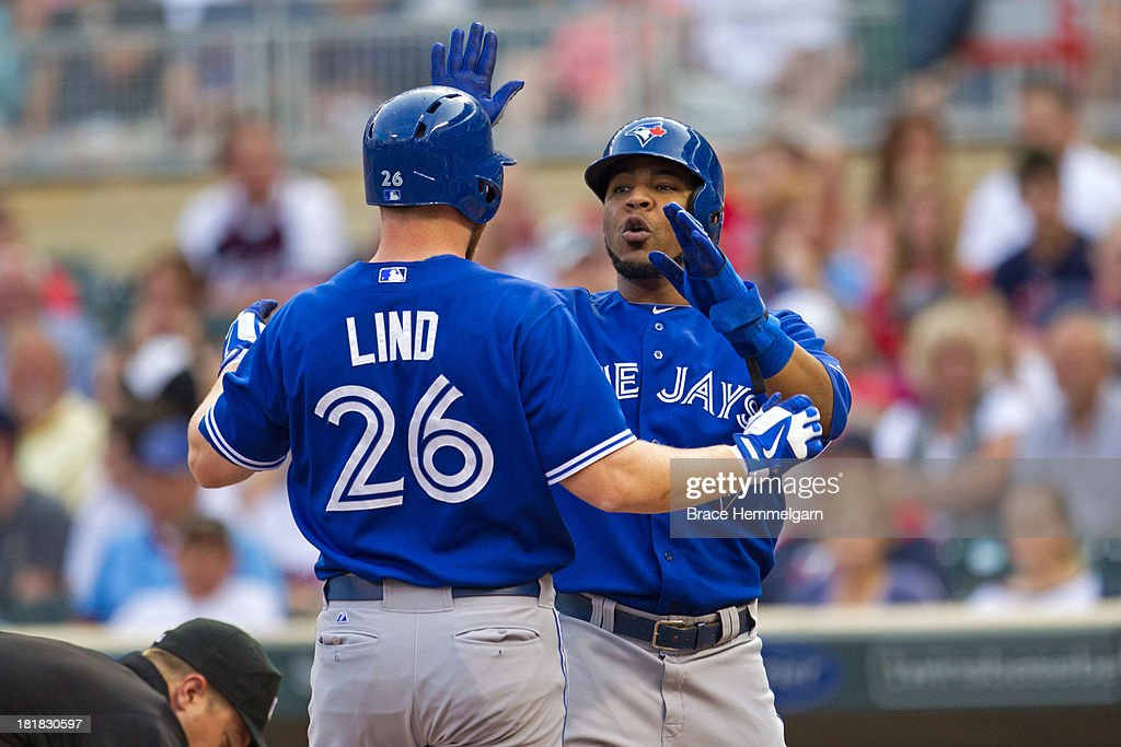 <a gi-track='captionPersonalityLinkClicked' href=/galleries/search?phrase=Adam+Lind&family=editorial&specificpeople=3911783 ng-click='$event.stopPropagation()'>Adam Lind</a> #26 of the Toronto Blue Jays is congratulated by <a gi-track='captionPersonalityLinkClicked' href=/galleries/search?phrase=Edwin+Encarnacion&family=editorial&specificpeople=598285 ng-click='$event.stopPropagation()'>Edwin Encarnacion</a> #10 after hitting a home run against the Minnesota Twins on August 7, 2013 at Target Field in Minneapolis, Minnesota. The Blue Jays defeated the Twins 11-2.