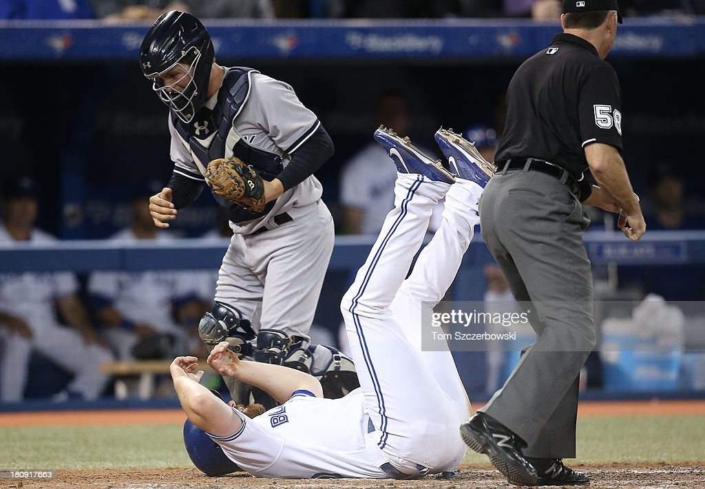 <a gi-track='captionPersonalityLinkClicked' href=/galleries/search?phrase=Adam+Lind&family=editorial&specificpeople=3911783 ng-click='$event.stopPropagation()'>Adam Lind</a> #26 of the Toronto Blue Jays is thrown out at home plate in the eighth inning during MLB game action as J.R. Murphy #66 of the New York Yankees tags him out on September 17, 2013 at Rogers Centre in Toronto, Ontario, Canada.