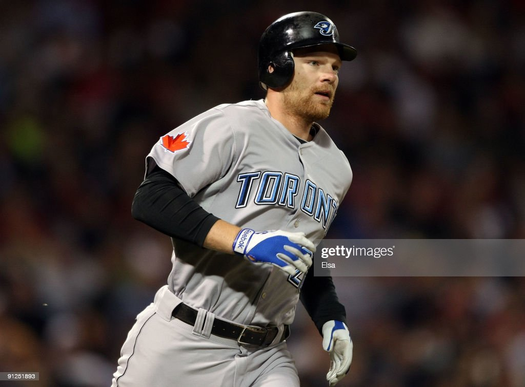 <a gi-track='captionPersonalityLinkClicked' href=/galleries/search?phrase=Adam+Lind&family=editorial&specificpeople=3911783 ng-click='$event.stopPropagation()'>Adam Lind</a> #26 of the Toronto Blue Jays rounds first base after his solo home run in the seventh inning against the Boston Red Sox on September 29, 2009 at Fenway Park in Boston, Massachusetts. It was Lind's third home run of the game.