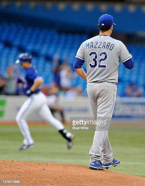 Adam Lind of the Toronto Blue Jays rounds the bases after hitting a three run home run in the bottom of the fourth inningas Vin Mazzaro of the Kansas...