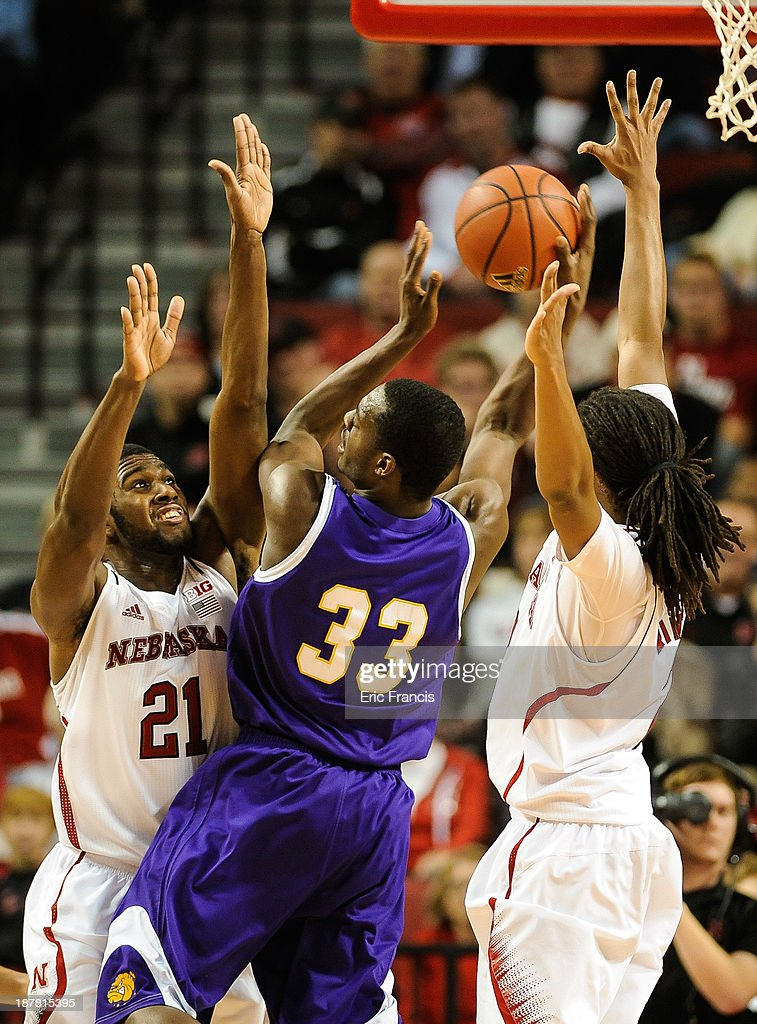 Adam Link #33 of the Western Illinois Leathernecks is defended by Leslee Smith #21 and David Rivers #2 of the Nebraska Cornhuskers during their game at Pinnacle Bank Arena on November 12, 2013 in Lincoln, Nebraska.