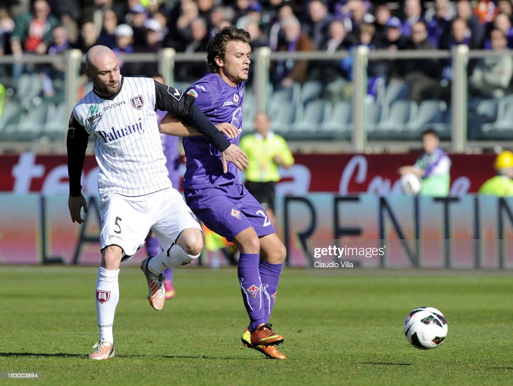 Adam Ljajic (R) of ACF Fiorentina and Roberto Guana of AC Chievo Verona compete for the ball during the Serie A match between ACF Fiorentina and AC Chievo Verona at Stadio Artemio Franchi on March 3, 2013 in Florence, Italy.