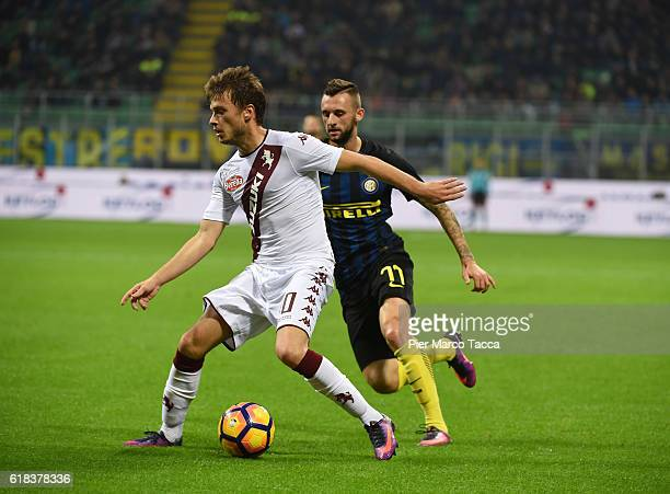 Adam Ljajic of FC Torino competes for the ball with Marcelo Brozovic of FC Internazionale during the Serie A match between FC Internazionale and FC...