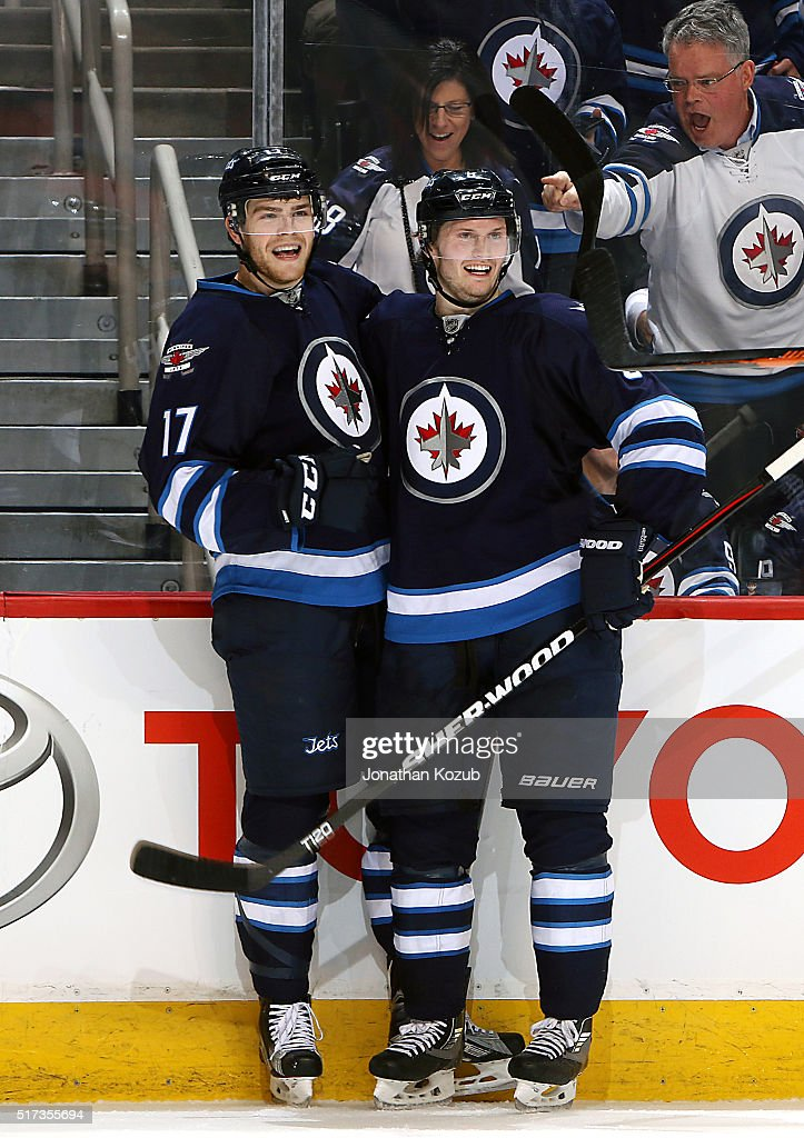Adam Lowry #17 and Jacob Trouba #8 of the Winnipeg Jets are all smiles as they celebrate a second period goal against the Los Angeles Kings at the MTS Centre on March 24, 2016 in Winnipeg, Manitoba, Canada.