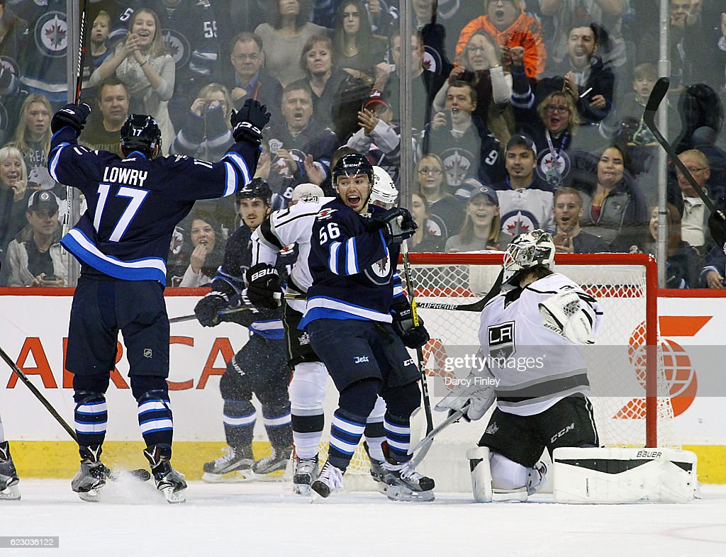 Adam Lowry #17 and Marko Dano #56 of the Winnipeg Jets react after scoring a first period goal against the Los Angeles Kings at the MTS Centre on November 13, 2016 in Winnipeg, Manitoba, Canada.