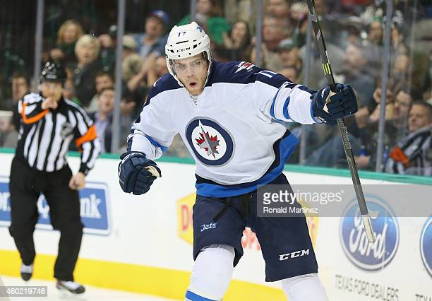 Adam Lowry of the Winnipeg Jets celebrates his first goal of the night against the Dallas Stars in the second period at American Airlines Center on...