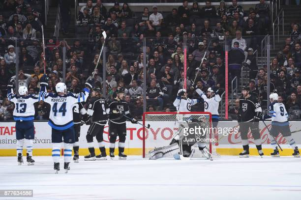 Adam Lowry of the Winnipeg Jets celebrates with teammates after scoring a goal against the Los Angeles Kings at STAPLES Center on November 22 2017 in...