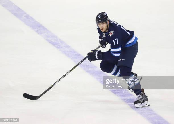 Adam Lowry of the Winnipeg Jets follows the play down the ice during second period action against the Ottawa Senators at the Bell MTS Place on...