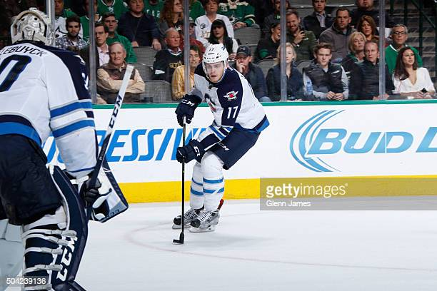 Adam Lowry of the Winnipeg Jets handles the puck against the Dallas Stars at the American Airlines Center on January 7 2016 in Dallas Texas