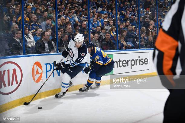 Adam Lowry of the Winnipeg Jets handles the puck against the St Louis Blues on January 31 2017 at Scottrade Center in St Louis Missouri