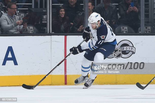 Adam Lowry of the Winnipeg Jets handles the puck during a game against the Los Angeles Kings at STAPLES Center on March 23 2017 in Los Angeles...