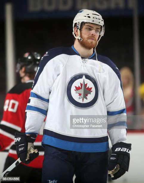 Adam Lowry of the Winnipeg Jets looks on during warm ups prior to the game against the New Jersey Devils on March 28 2017 at the Prudential Center in...