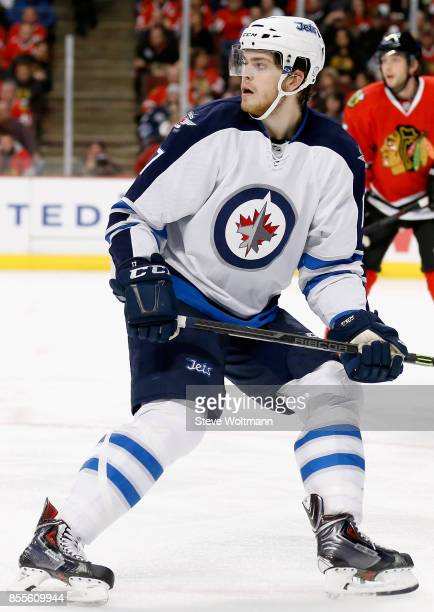 Adam Lowry of the Winnipeg Jets plays in a game against the Chicago Blackhawks at the United Center on December 23 2014 in Chicago Illinois