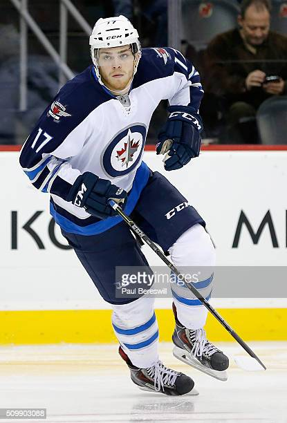 Adam Lowry of the Winnipeg Jets plays in the game against the New Jersey Devils at Prudential Center on October 30 2014 in Newark New Jersey