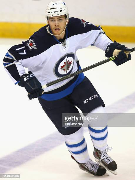Adam Lowry of the Winnipeg Jets plays in the game against the St Louis Blues at the Scottrade Center on April 7 2015 in St Louis Missouri