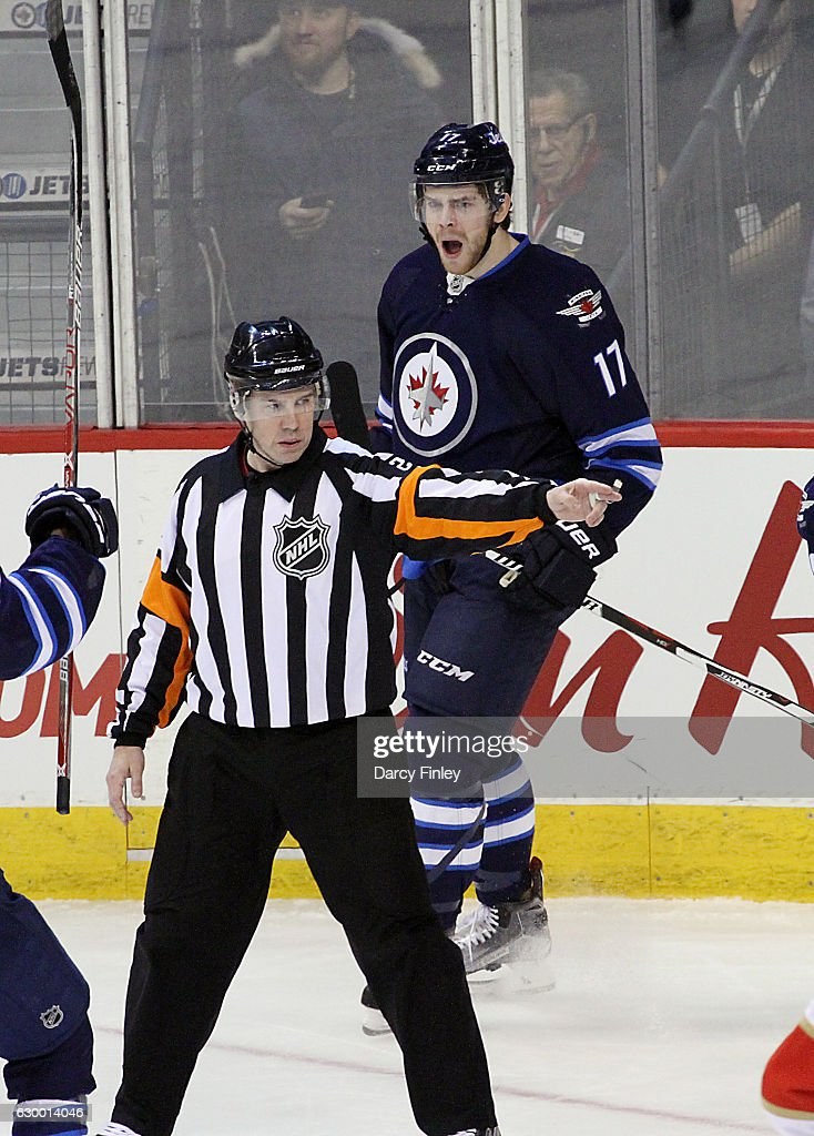 Adam Lowry #17 of the Winnipeg Jets reacts as referee Ian Walsh #29 signals a goal against the Florida Panthers during second period action at the MTS Centre on December 15, 2016 in Winnipeg, Manitoba, Canada.