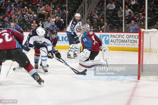 Adam Lowry of the Winnipeg Jets scores against Goaltender Calvin Pickard of the Colorado Avalanche at the Pepsi Center on February 4 2017 in Denver...