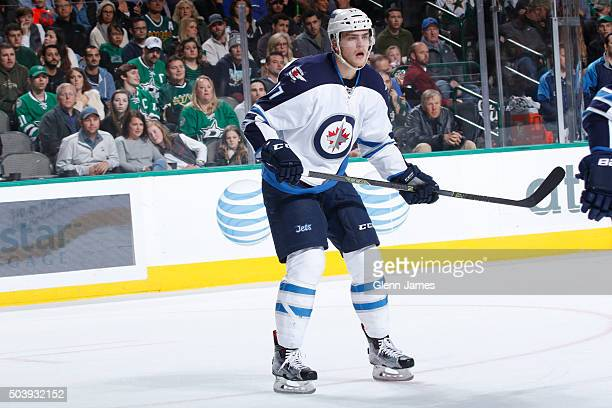 Adam Lowry of the Winnipeg Jets skates against the Dallas Stars at the American Airlines Center on January 7 2016 in Dallas Texas