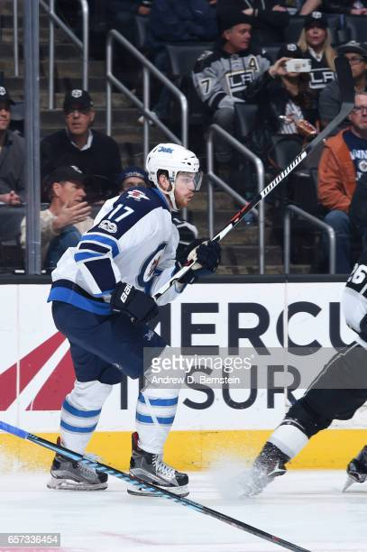 Adam Lowry of the Winnipeg Jets skates on ice during a game against the Los Angeles Kings at STAPLES Center on March 23 2017 in Los Angeles California
