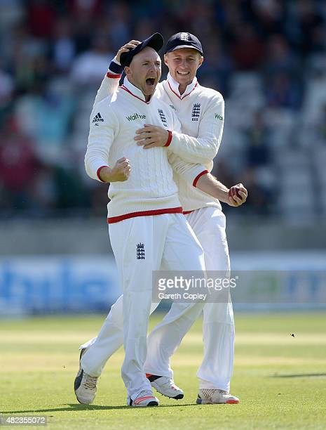 Adam Lyth of England celebrates with Joe Root after catching out Australian captain Michael Clarke during day two of the 3rd Investec Ashes Test...