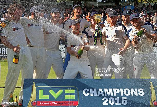 Adam Lyth pops a bottle of champagne as Yorkshire celebrate becoming LV County Champions following the LV County Championship match between Middlesex...
