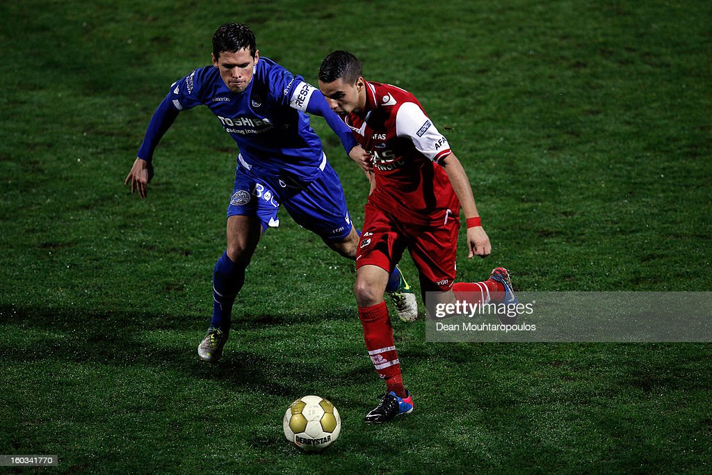Adam Maher of AZ Alkmaar and Bart van Brakel of Den Bosch battle for the ball during the KNVB Dutch Cup match between FC Den Bosch and AZ Alkmaar at BrainWash Stadion De Vliert on January 29, 2013 in Bosch, Netherlands.