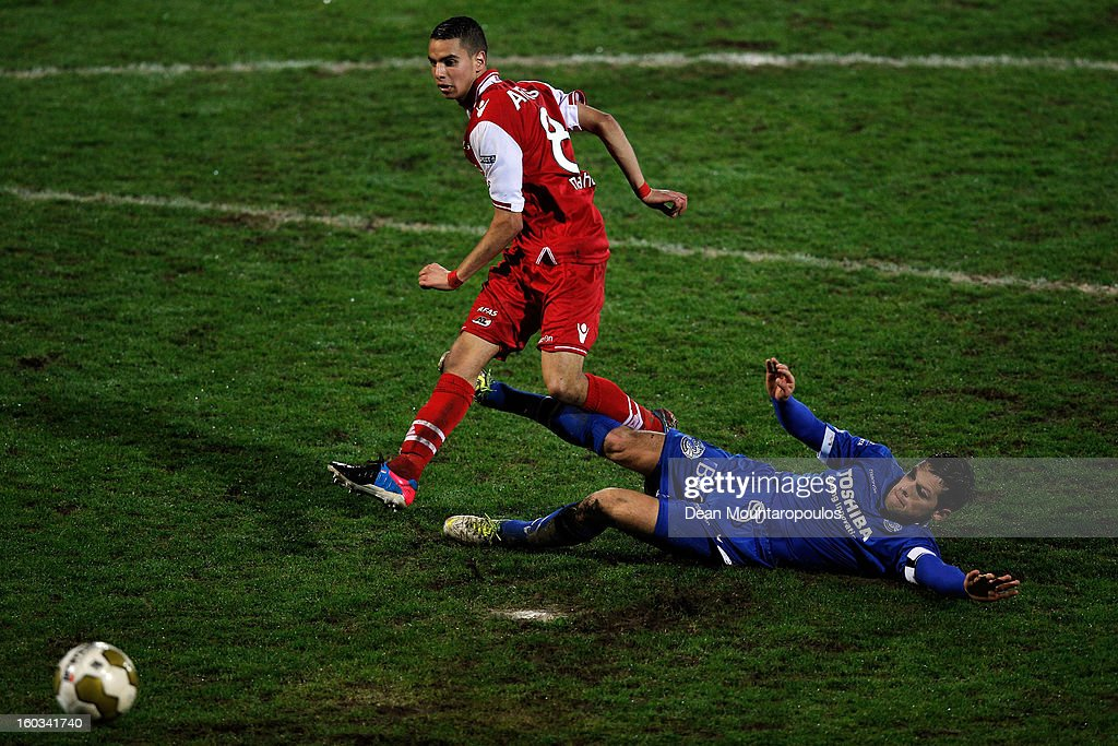 Adam Maher of AZ Alkmaar shoots and scores a goal as Bart van Brakel of Den Bosch attempts the tackle during the KNVB Dutch Cup match between FC Den Bosch and AZ Alkmaar at BrainWash Stadion De Vliert on January 29, 2013 in Bosch, Netherlands.