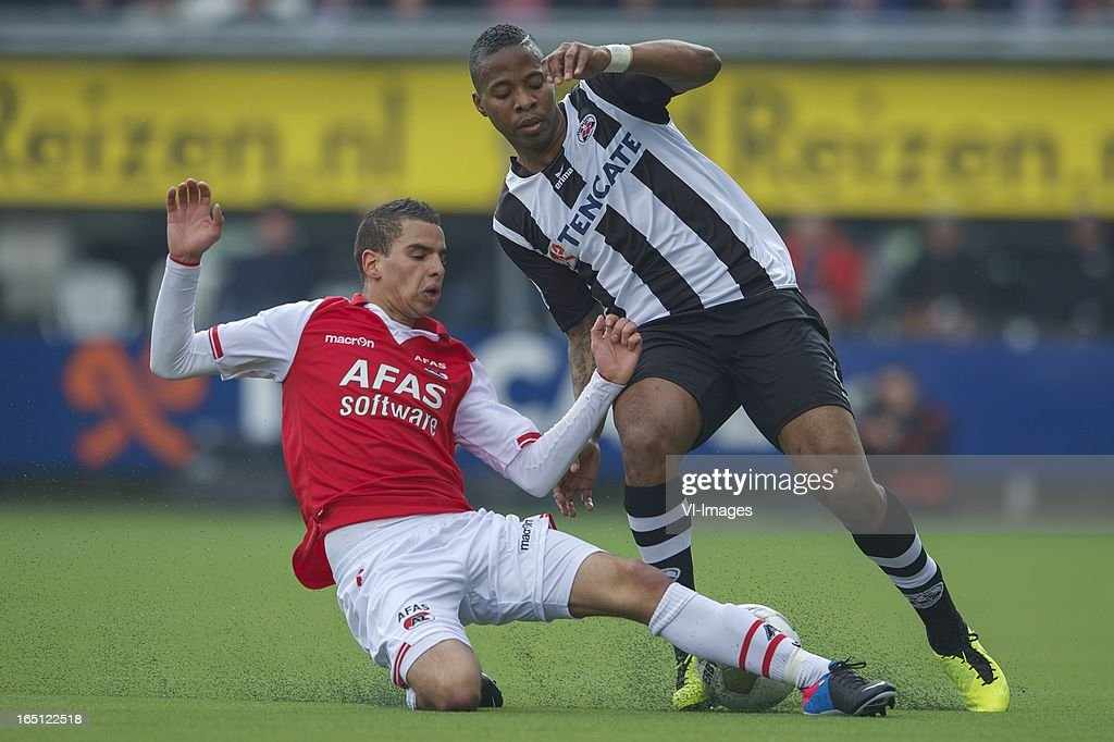 Adam Maher of AZ, Milano Koenders of Heracles Almelo during the Dutch Eredivisie match between Heracles Almelo and AZ Alkmaar at the Polman Stadium on march 31, 2013 in Almelo, The Netherlands