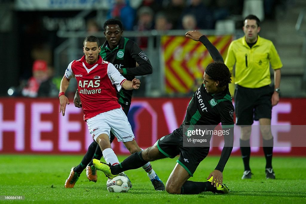 Adam Maher of AZ, Oluwafemi Ajilore of FC Groningen, Virgil van Dijk of FC Groningen during the Dutch Eredivisie match between AZ Alkmaar and FC Groningen at the AFAS Stadium on february 2, 2013 in Alkmaar, The Netherlands