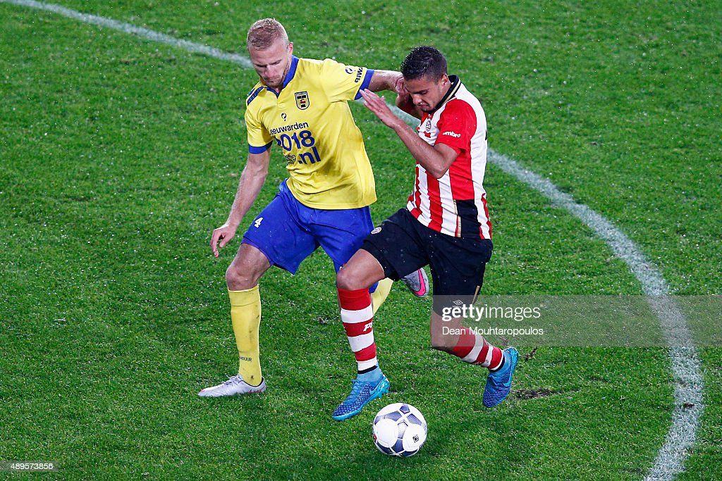 Adam Maher of PSV battles for the ball with Vytautas Andriuskevicius of Cambuur during the KNVB Cup 2nd round match between PSV Eindhoven and SC...
