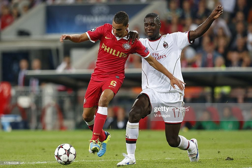 , Adam Maher of PSV, Cristian Zapata of AC Milan during the Champions League qualifier match between PSV and AC Milan at Philips stadium on August 20, 2013 in Eindhoven, The Netherlands.
