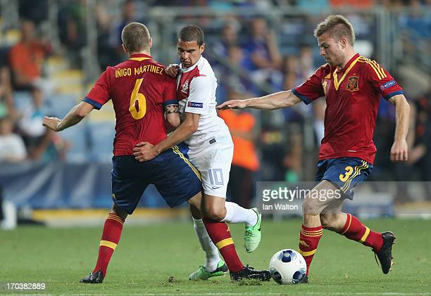 Adam Maher of the Netherlands is tackled by Inigo Martinez of Spain during the UEFA European U21 Championships Group B match between Spain and...