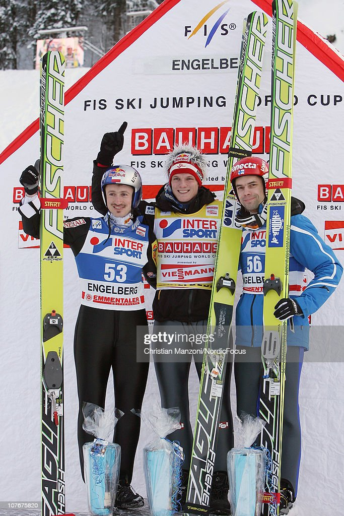 <a gi-track='captionPersonalityLinkClicked' href=/galleries/search?phrase=Adam+Malysz&family=editorial&specificpeople=208124 ng-click='$event.stopPropagation()'>Adam Malysz</a> (second) of Poland celebrates with <a gi-track='captionPersonalityLinkClicked' href=/galleries/search?phrase=Thomas+Morgenstern&family=editorial&specificpeople=221616 ng-click='$event.stopPropagation()'>Thomas Morgenstern</a> (winner) of Austria and <a gi-track='captionPersonalityLinkClicked' href=/galleries/search?phrase=Matti+Hautamaeki&family=editorial&specificpeople=221562 ng-click='$event.stopPropagation()'>Matti Hautamaeki</a> (third) of Finland after the individual HS137 during the FIS Ski Jumping World Cup on December 18, 2010 in Engelberg, Switzerland.